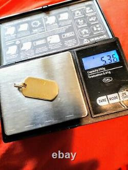 9ct gold dog tag pendant. Hallmarked A heavy 5.3 grams weight! Solid gold