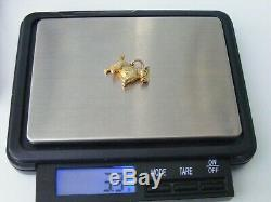 A RARE 9ct. ARTICULATED SOLID GOLD SCOTTIE DOG, FOB, CHARM, PENDANT. 3.3grms