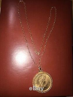 Rare solid gold $1000 year of dog necklace